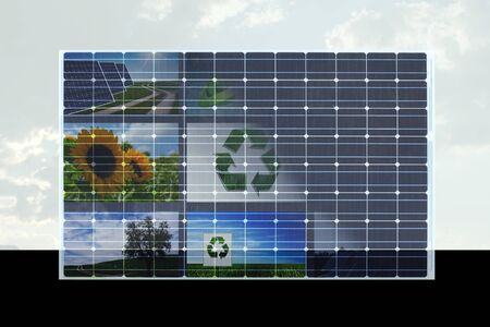 solarpower: solar cell with natural symbols on it against cloudy sky Stock Photo
