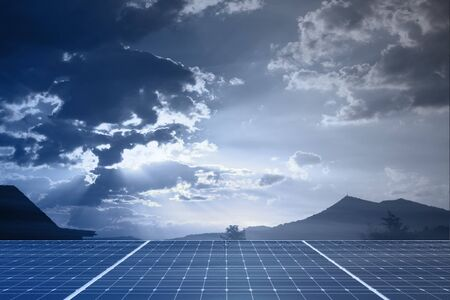 solarpower: solar panel against sunny sky with clouds