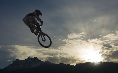 mountainbike: mountainbike jump against sky