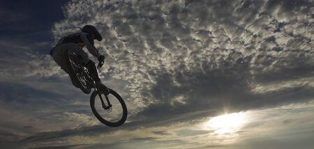 mountainbike: mountainbike jump against sky