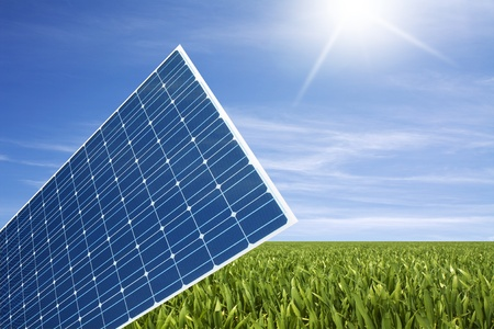 solarpower: solar panel in the green grass