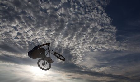 mountainbike: mountainbike stunt against sky