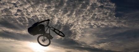 mountainbike stunt against sky