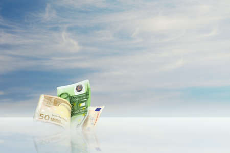globalism: euro money with sky background