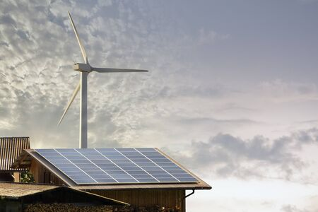 renewable energy: Photovoltaic panel and wind mill ecologic energy production Stock Photo