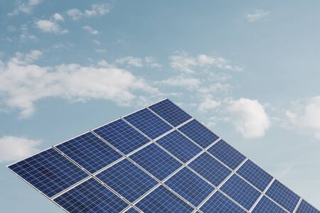 energy production: Solar panel equipment for renewable energy production against cloudy sky Stock Photo