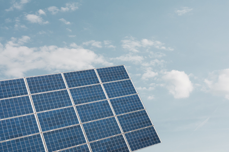 solarcell: Solar panel equipment for renewable energy production against cloudy sky Stock Photo