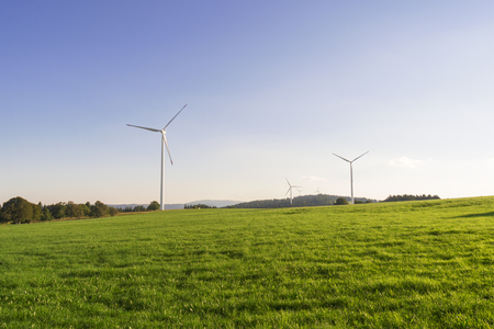 energy production: Wind mills park for ecological wind energy production Stock Photo