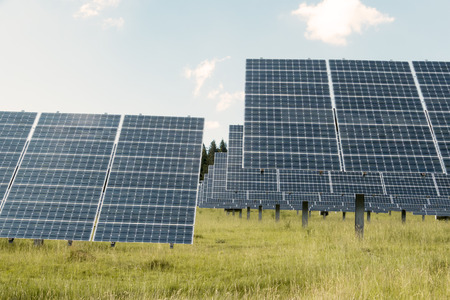 energy production: Photovoltaic panels on meadow for ecological energy production Stock Photo