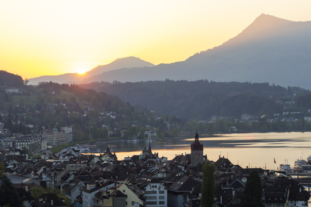 citytrip: Old town of lucerne city from above in the great morning sun light with lake lucerne and popular mountain Rigi in background