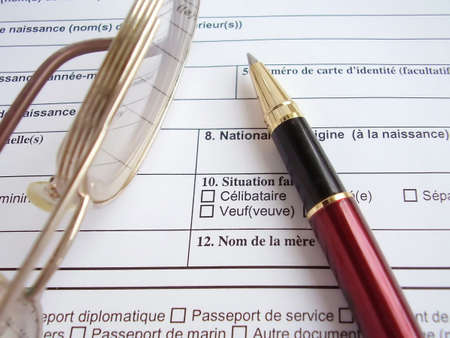 fill fill in: Tool in to fill a visa to France Stock Photo