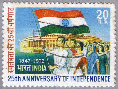 marchers: INDIA - CIRCA 1972: A stamp printed in India shows marchers with flag, circa 1972