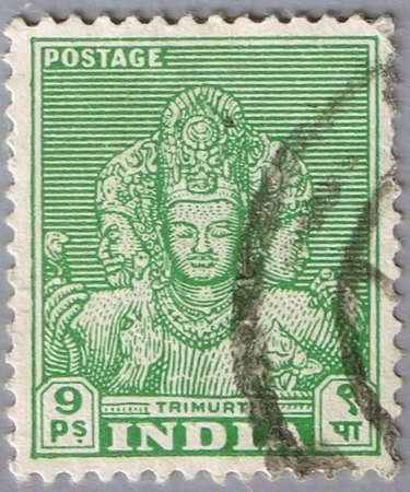 trimurti: INDIA - CIRCA 1949: A stamp printed in India shows trimurti, series, circa 1949