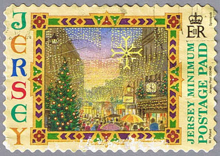 JERSEY - CIRCA 2004: A stamp printed in Jersey shows Street with Christmas decorations, series, circa 2004 photo