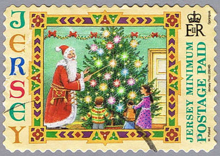 JERSEY - CIRCA 2004: A stamp printed in Jersey shows Santa Claus and children, series, circa 2004 photo