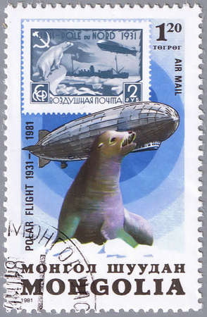 graf: MONGOLIA - CIRCA 1981: A stamp printed in Mongolia shows seal, a series devoted to the 50-th anniversary of flight and the airship Graf Zeppelin, circa 1981 Stock Photo