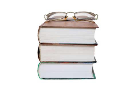 Eyeglasses on the books isolated on white photo