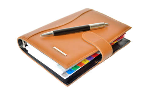 Daily planner with pen on a white background