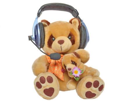 Teddy bear listening to music Stock Photo