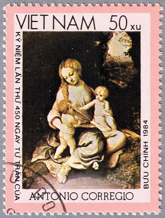 VIETNAM - CIRCA 1984: A stamp printed in Vietnam shows a reproduction of Correggio or Antonio Allegri painting - Madonna and Child with St. John, series, circa 1984 photo