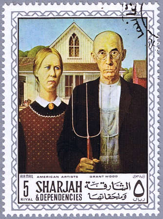famous painting: SHARJAH - CIRCA 1968: A stamp printed in Sharjah shows painting of Grant Wood - American Gothic, series, circa 1968 Stock Photo