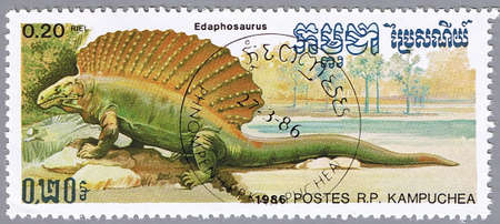 KAMPUCHEA - CIRCA 1986: A stamp printed in Kampuchea shows Edaphosaurus, series devoted to prehistoric animals, circa 1986 Stock Photo