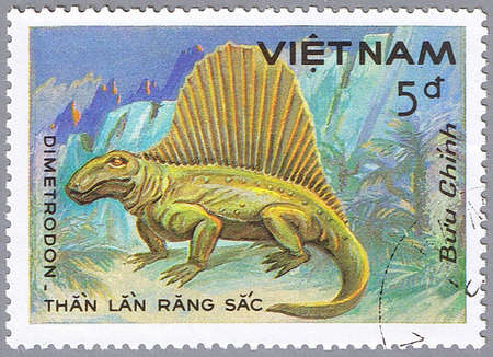 devoted: VIETNAM - CIRCA 1984: A stamp printed in Vietnam shows Dimetrodon, series devoted to prehistoric animals, circa 1984 Stock Photo
