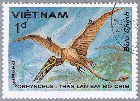 VIETNAM - CIRCA 1984: A stamp printed in Vietnam shows Rhamphorhynchus, series devoted to prehistoric animals, circa 1984 Stock Photo