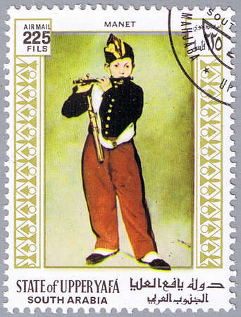 STATE OF UPPER YAFA - CIRCA 1967: A stamp printed in State of Upper Yafa shows painting of Eduard Manet - Young Flautist or The Fifer, series, circa 1967 Stock Photo - 9056401