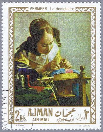 circa: AJMAN - CIRCA 1968: A stamp printed in Ajman shows painting of Johan Vermeer - The Lacemaker, series, circa 1968 Stock Photo