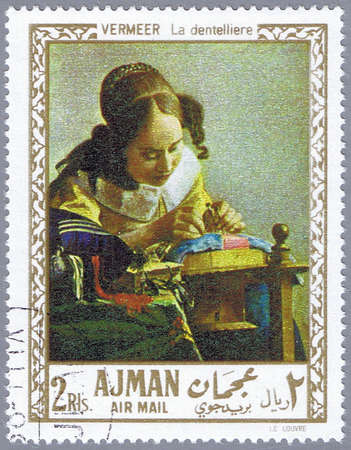 AJMAN - CIRCA 1968: A stamp printed in Ajman shows painting of Johan Vermeer - The Lacemaker, series, circa 1968 Stock Photo