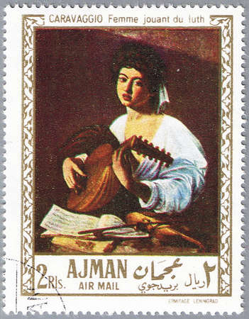 lute: AJMAN - CIRCA 1968: A stamp printed in Ajman shows painting of Caravaggio - Lute Player, series, circa 1968 Stock Photo