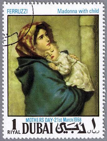 madonna: DUBAI - CIRCA 1968: A stamp printed in Dubai shows painting of Roberto Ferruzzi - Madonna with child, series, circa 1968