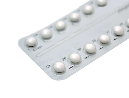Birth control pills on white