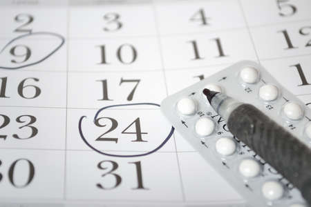 packs of pills: Birth control pills and pen closeup