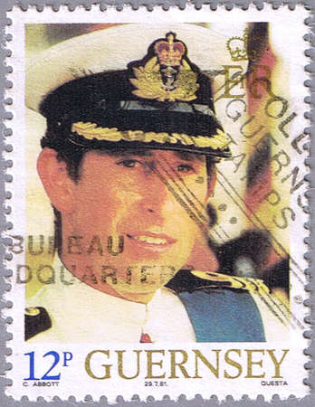 lady diana: GUERNSEY - CIRCA 1981: A stamp printed in Guernsey shows portrait of Prince Charles, series is devoted to the royal wedding of Prince Charles to Lady Diana Spencer, circa 1981