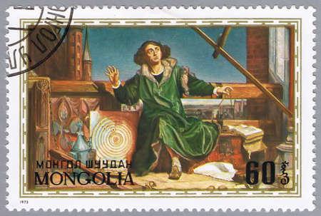 collectible: MONGOLIA - CIRCA 1973: A stamp printed in Mongolia shows image of Nicolaus Copernicus, the Polish astronomer, series, circa 1973  Stock Photo
