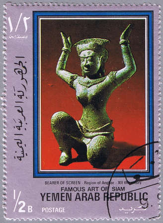 bearer: YEMEN - CIRCA 1968: A stamp printed Yemen shows the sculpture - Bearer of screen, series is devoted to the art of Siam, circa 1968 Stock Photo