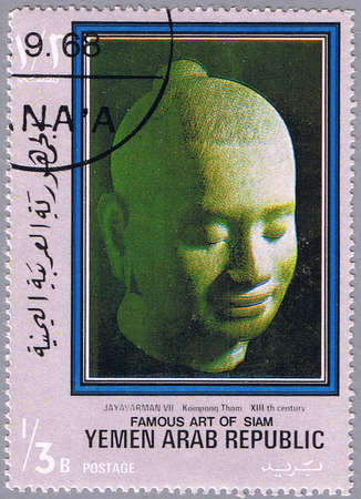 siam: YEMEN - CIRCA 1968: A stamp printed Yemen shows a sculpted head of Jayavarman, series is devoted to the art of Siam, circa 1968