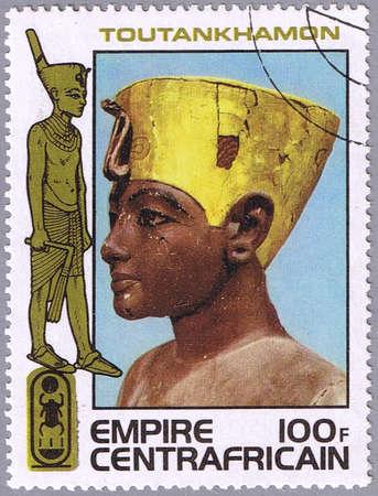 tutankhamen: CENTRAL AFRICAN EMPIRE - CIRCA 1978: A stamp printed Central African Empire shows the head of Tutankhamen, a series devoted to the treasures of ancient Egyptian art, circa 1978 Stock Photo