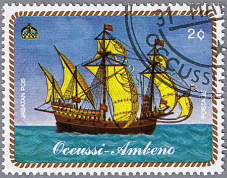 OCCUSSI-AMBENO - CIRCA 1977: A stamp printed in Occussi-Ambeno shows a sailing ship, series, circa 1977 Stock Photo