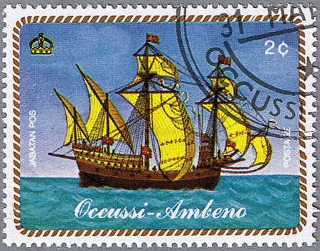 OCCUSSI-AMBENO - CIRCA 1977: A stamp printed in Occussi-Ambeno shows a sailing ship, series, circa 1977 Stock Photo