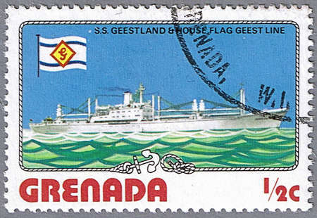 GRENADA - CIRCA 1976: A stamp printed in Grenada shows S.S. Geestland and Geest Line Flag, series is devoted to ships, circa 1976 photo