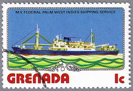 GRENADA - CIRCA 1976: A stamp printed in Grenada shows M.V. Federal Palm, series is devoted to ships, circa 1976 photo