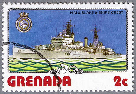 GRENADA - CIRCA 1976: A stamp printed in Grenada shows H.M.S. Blake and ship�s crest, series is devoted to ships, circa 1976 photo