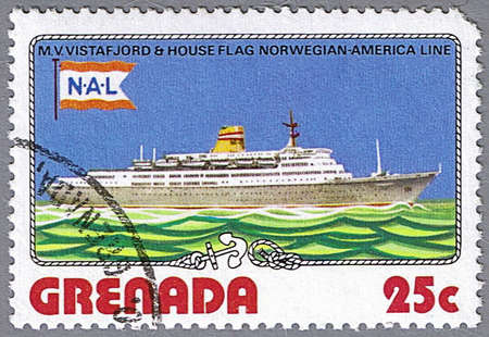 GRENADA - CIRCA 1976: A stamp printed in Grenada shows M.V. Vistafjord and Norwegian - American Line flag, series is devoted to ships, circa 1976 photo