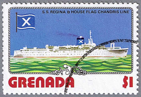 GRENADA - CIRCA 1976: A stamp printed in Grenada shows S.S. Regina and Chandris Line flag, series is devoted to ships, circa 1976 photo