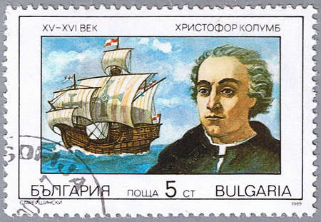 BULGARIA - CIRCA 1989: A stamp printed in Bulgaria shows a portrait of Columbus, series is devoted to explorers and their ships, circa 1989 photo