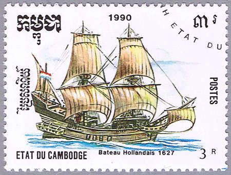CAMBODIA - CIRCA 1990: A stamp printed in Cambodia shows Dutch boat, series is devoted to sailing vessels, circa 1990 photo