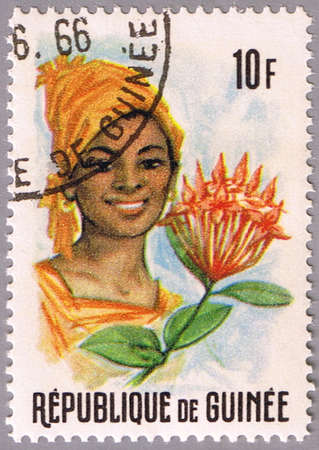 GUINEA - CIRCA 1966: A stamp printed in Guinea shows shows the portrait of a woman and flower, series, circa 1966 Stock Photo - 10691246